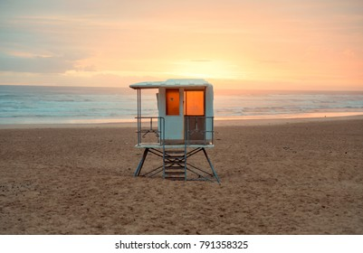 Lifeguard tower overlooking a tropical beach sunset