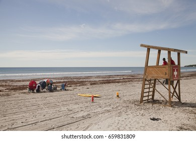 Lifeguard tower and swimmers on York beach, USA.