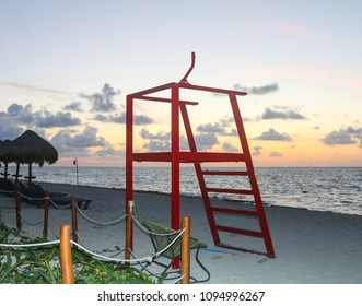 A lifeguard tower at a tropical beach.