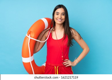 Lifeguard woman over isolated blue background with lifeguard equipment and with happy expression