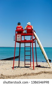 Lifeguards observing beach from tower