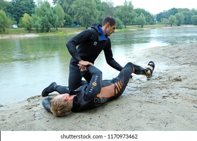 Lifeguards showing position of body of a drowning before doing mouth-to-mouth resuscitation. Demonstration for mass-media organized by Police Directorate. August 10,2018. Kiev, Ukraine