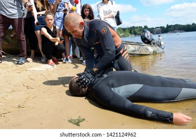 Lifeguards showing position of drowning body before doing mouth-to-mouth resuscitation. Demonstration for mass-media organized by Police Directorate. August 10,2018. Kiev, Ukraine