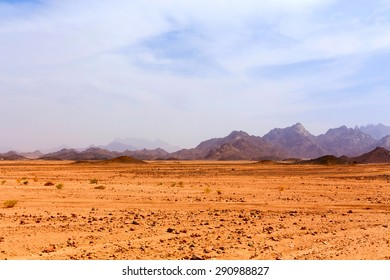 Lifeless hot desert with mountains in Egypt, Africa