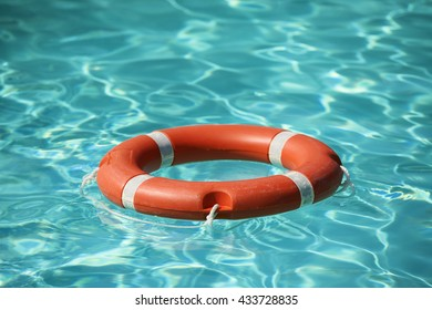 Lifesaver floating in the swimming pool.
