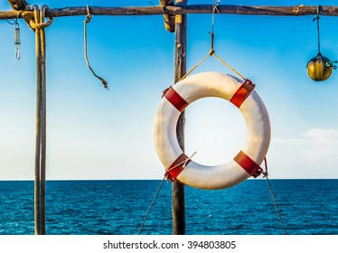 lifesaver hanging on a basic wooden structure on the coast