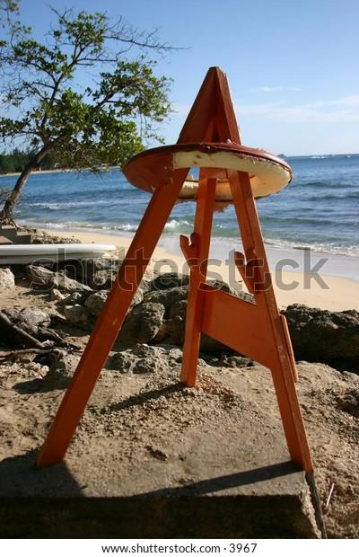 lifesaver suspended on beach pedestal