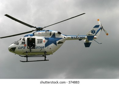 Lifestar rescue helicopter flying over Westerly, Rhode Island. Editorial use only.