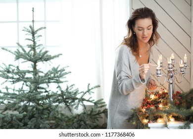 Lifestyle. Beautiful girl is at home during Christmas
