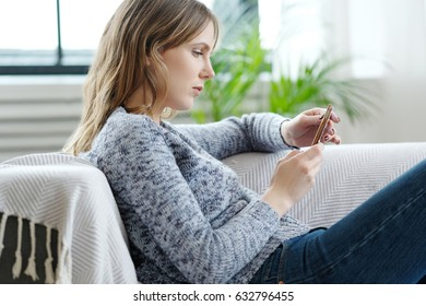 Lifestyle. Beautiful woman at home