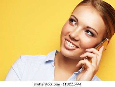 lifestyle, business  and people concept: Portrait of smiling business woman phone talking over yellow background