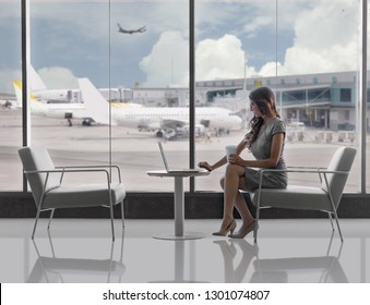 Lifestyle business woman, executive traveller working on laptop in airport terminal, with copy space