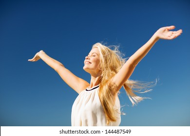 lifestyle concept - beautiful happy woman enjoying summer outdoors
