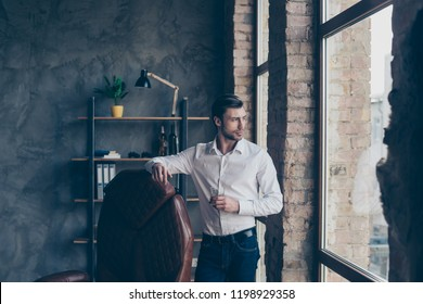 Lifestyle concept. Handsome attractive well-dressed good-looking gentle man in formal wear drink cognac liquor liquid beverage look aside stand in light indoor