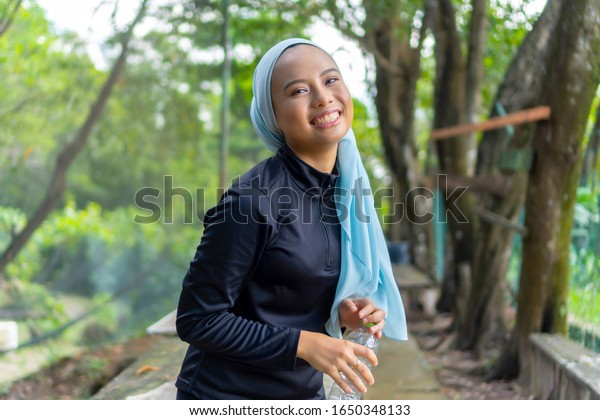 Lifestyle Concept, Portrait of Malay Muslim lady wearing hijab outdoor