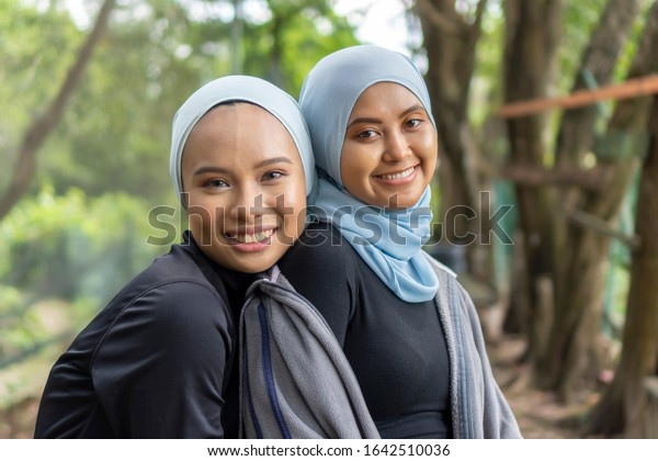 Lifestyle Concept, Portrait of two Malay Muslim lady wearing hijab outdoor