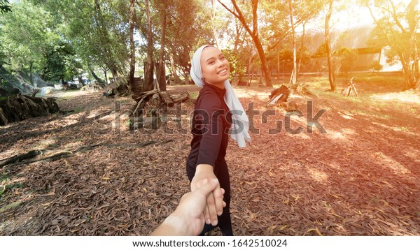 Lifestyle Concept, Two Malay Muslim lady wearing hijab outdoor, follow me pov