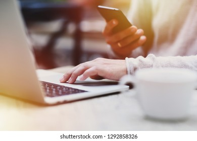 Lifestyle education student. Businessman work on laptop for project. Millennial at home office drink coffee looking for job on notebook. Unrecognizable man using modern portable computer and phone.