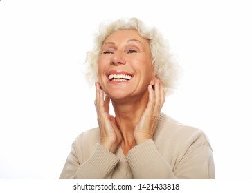 lifestyle, emotion and people concept: Close up portrait of happy senior woman smiling over white background