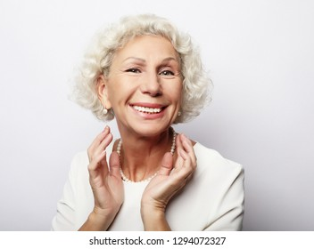 lifestyle, emotion  and people concept: Grey haired old nice beautiful laughing woman. Isolated over vwhite  background. Close up.