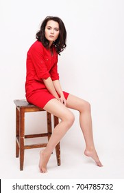 lifestyle, fashion and people concept: young woman wearing red d
