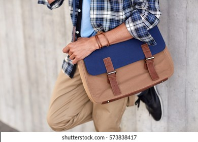 lifestyle, fashion, style and people concept - close up of hipster man with stylish shoulder bag