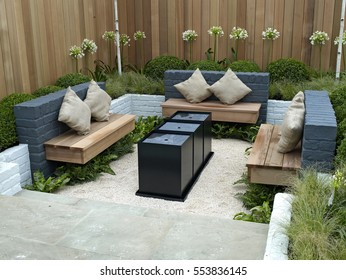 A lifestyle garden combining outdoor and indoor living with seating area
