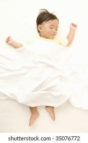 LIFESTYLE IMAGE-a sleeping baby isolated on white