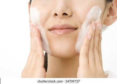 LIFESTYLE IMAGE-close-up shot of a Japanese woman's face with soap bubbles
