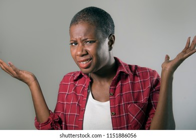 lifestyle isolated portrait of young pretty and unhappy black african American woman gesturing with hands and face expression as if unable to understand or asking for explanations