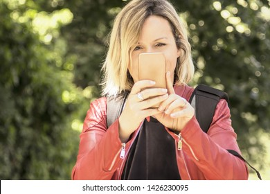 Lifestyle leisure people person photographer social network concept. Close up photo of charming lady looking camera holding telephone taking photo