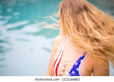 A lifestyle moment of a beautiful young woman celebrating the 4th of July