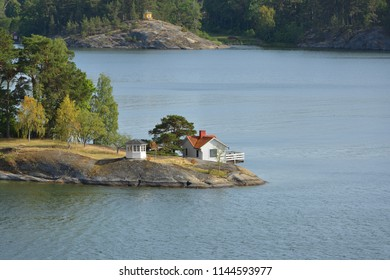 Lifestyle on islands. Stockholm archipelago island, largest archipelago in Sweden, and second-largest archipelago in Baltic Sea. White house with red roof