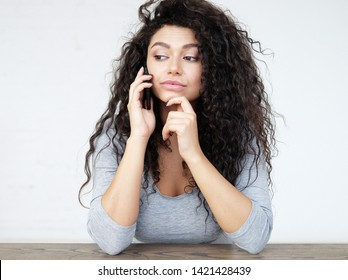 lifestyle and people concept - Beautiful afro american woman using mobile phone, close up