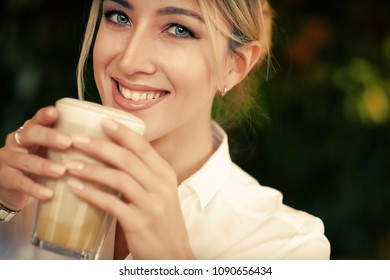 lifestyle and people concept: Beautiful Girl With Cup of Coffee