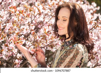 lifestyle and people concept: Beautiful woman in blossom garden