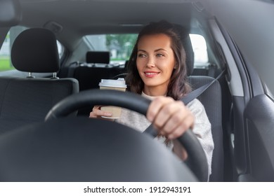 lifestyle and people concept - happy smiling young woman or female driver driving car and drinking takeaway coffee