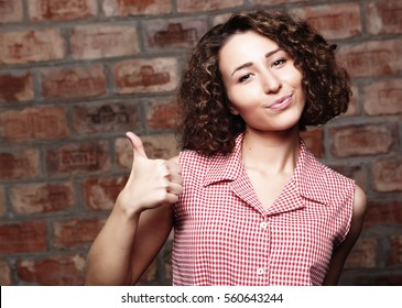 lifestyle  and people concept: Happy woman giving thumb up