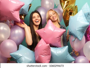 lifestyle and people concept: two girls friends with colorfoul air balloons - young and happy.
