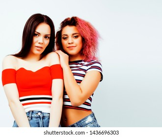 lifestyle people concept: two pretty stylish modern hipster teen girl having fun together, diverse nation mixed races, happy smiling making selfie