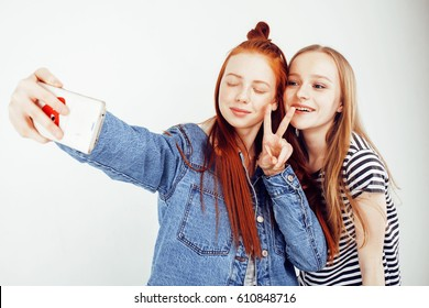 lifestyle people concept: two pretty stylish modern hipster teen girl having fun together, happy smiling making selfie