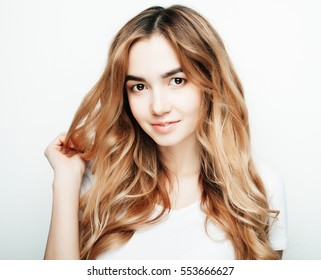 lifestyle and people concept: Young casual woman portrait. Clean face, curly hair.
