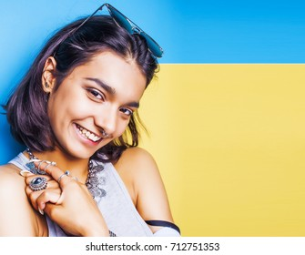 lifestyle people concept. young pretty smiling indian girl with long nails wearing lot of jewelry rings, asian summer happy cool  copyspace