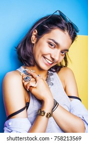 lifestyle people concept. young pretty smiling indian girl with long nails wearing lot of jewelry rings, asian summer happy cool close up