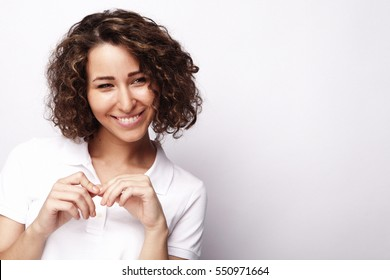 lifestyle and people concept:Young happy woman with curly hair