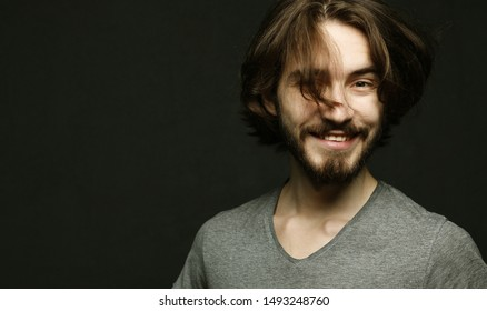 lifestyle and people concept:young man has excited expression, dresssed casually