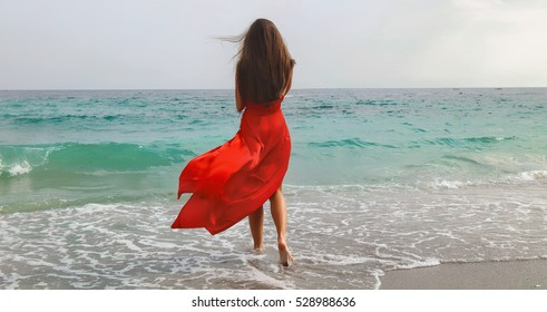 lifestyle photo of woman with perfect hair.walking alone at the beach.Sensual young girl relaxing.Colorful filter.glam style,teen trend outfit, positive mood,smiling,amazing model girl,long hair - Shutterstock ID 528988636