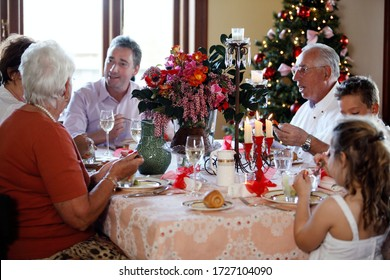 Lifestyle photography of a family at lunch on Christmas day