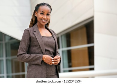 Lifestyle portrait of businesswoman, executive female, corporate professional at office building, possibly legal or financial planner representative