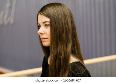 Lifestyle portrait of Real Young pretty woman with long hair